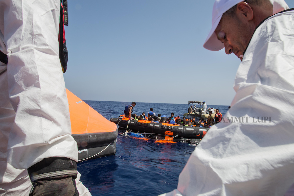 Surviving migrants are brought aboard Irish and Italian Navy life-boats in the area where their wooden boat migrants capsized and sank off the coast of Libya August 5, 2015.  A boat packed with up to 700 African migrants capsized in the Mediterranean Sea off the coast of Libya on Wednesday and many were feared dead, officials and aid agencies said. <br /> REUTERS/Marta Soszynska/MSF/ Handout<br /> NO ARCHIVE. NO COMMERCIAL USE. NO SALES