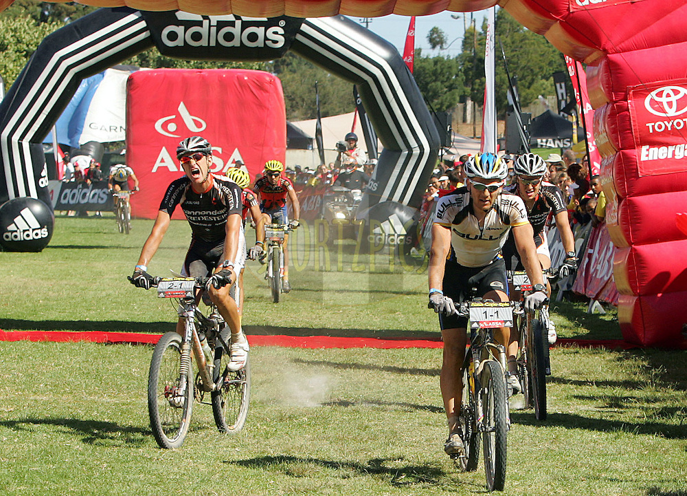 WESTERN CAPE, SOUTH AFRICA -  31 March 2008, Karl Platt of team Bulls just beats Roel Paulissen to win the sprint to the end of stage 3 of the 2008 Absa Cape Epic Mountain Bike stage race from Calitzdorp Spa..to Langenhoven High School in Riversdale, Western Cape, South Africa...Photo by Ron Gaunt/SPORTZPICS