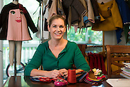 Molly Goodall poses for a portrait with children jackets she designs at her home in McKinney, Texas on September 11, 2015. (Cooper Neill for The New York Times)