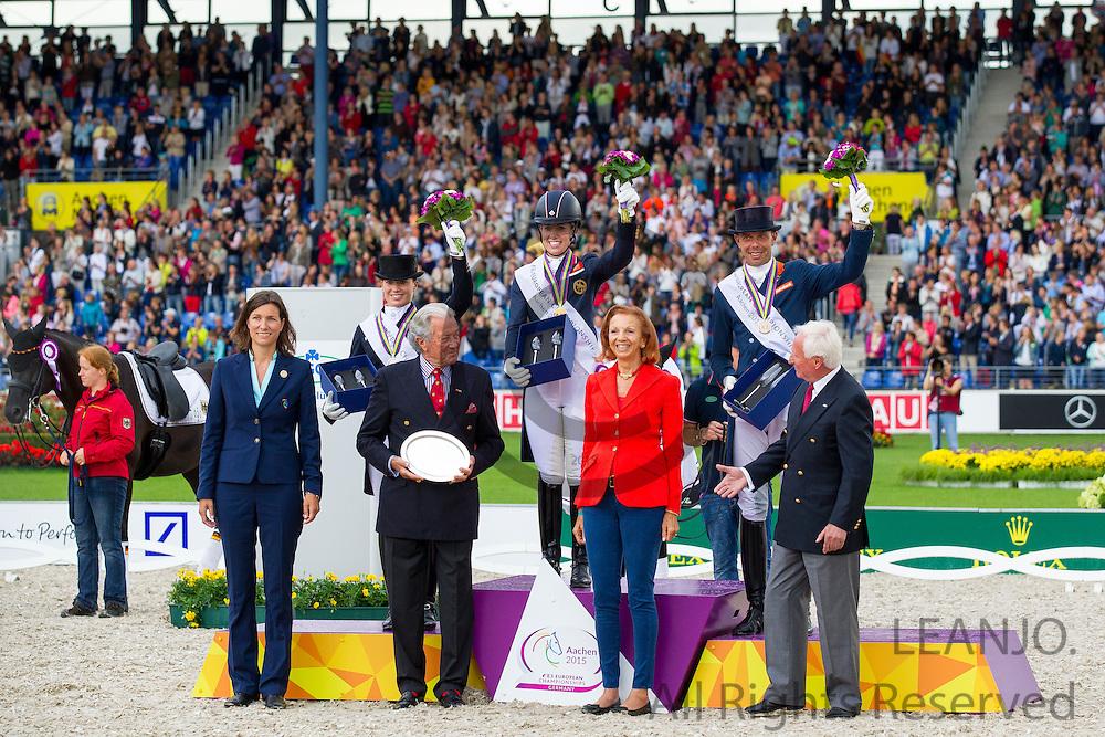 Podium Grand Prix Special 1. Charlotte Dujardin - Valegro, 2. Kristina Broring Sprehe - Desperados, 3. Hans Peter Minderhoud - Glock's Johnson TN<br /> FEI European Championships Aachen 2015<br /> &copy; DigiShots