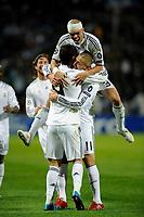FOOTBALL - UEFA CHAMPIONS LEAGUE 2009/2010 - GROUP C - OLYMPIQUE MARSEILLE v REAL MADRID - 8/12/2009 - PHOTO FRANCK FAUGERE / DPPI - CRISTIANO RONALDO (REAL) CELEBRATES HIS GOAL WITH KARIME BENZEMA AND PEPE