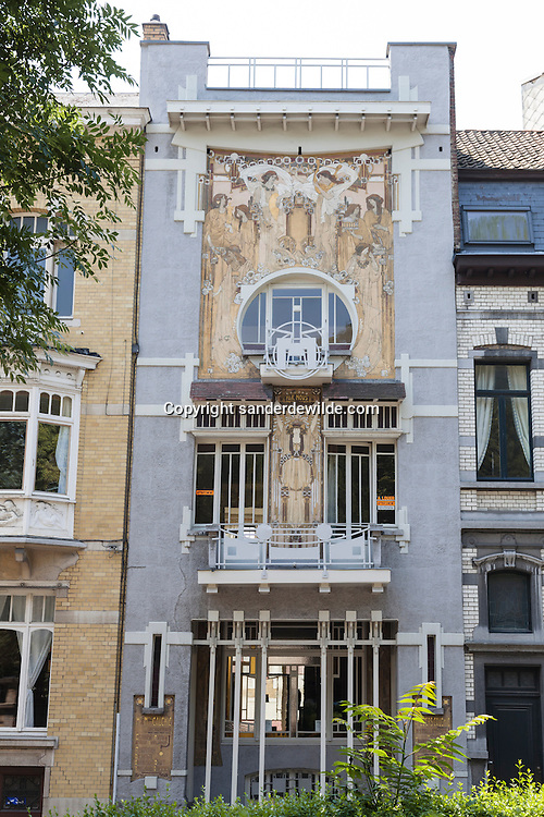 The Cauchie House, the private house of Paul Cauchie and his love Caroline Voet, built in 1905, can be considered as one of the most beautiful works of Art Nouveau in Brussels. It is a privately owned house and the first floor is now for rent, with original furniture inside. In close proximity to the Cinquantenaire Park and in clear view Paul Cauchie designed the front of the house like a giant advertising billboard.