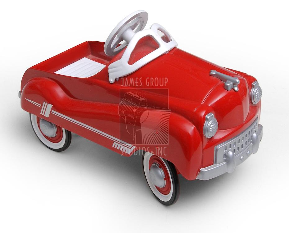 1950's era red toy car on white background
