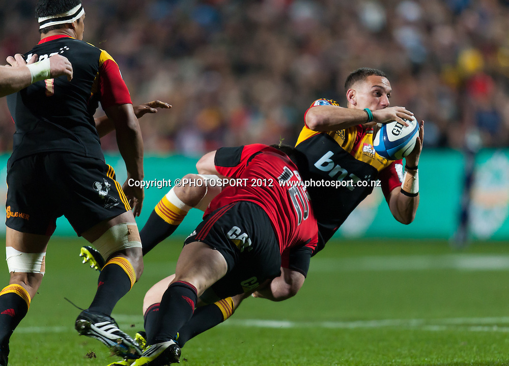 Chiefs' Aaron Cruden tackled by Crusaders' Ryan Crotty during the Super Rugby Semi Final won by the Chiefs (20-17) against the Crusaders at Waikato Stadium, Hamilton, New Zealand, Friday 27 July 2012. Photo: Stephen Barker/Photosport.co.nz