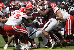 Louisiana-Lafayette running back Trey Ragas (9) takes a pile of Texas A&M defenders with him over the goal line for a touchdown during the second quarter of an NCAA college football game Saturday, Sept. 16, 2017, in College Station, Texas. (AP Photo/Sam Craft)