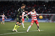 Doncaster Rovers Midfielder Tommy Rowe (10) holds back Bristol Rovers Defender Joe Partington during the EFL Sky Bet League 1 match between Doncaster Rovers and Bristol Rovers at the Keepmoat Stadium, Doncaster, England on 27 January 2018. Photo by Craig Zadoroznyj.