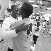 1International Rescue Committee case workers greet the Burundian refugees who arrived with their families at Phoenix Sky Harbor International Airport on June 1, 2007. Though these 15 refugees were suppose to arrive the previous night they missed the plane because they couldn't speak English.