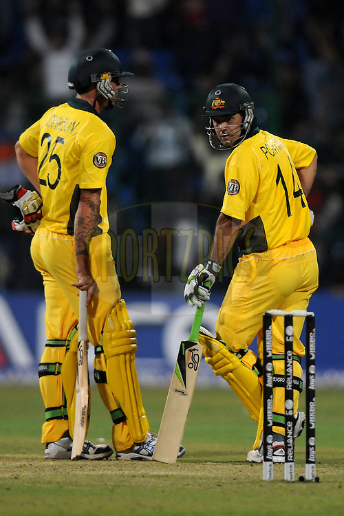 Ricky Ponting of Australia has a closer look at the stumps as he gets stumped out during the World Cup warm up match between India and Australia (B) held at the M Chinnaswamy Stadium in Bengaluru, Bangalore, Karnataka, India on the 13 February 2011..Photo by Pal Pillai/BCCI/SPORTZPICS