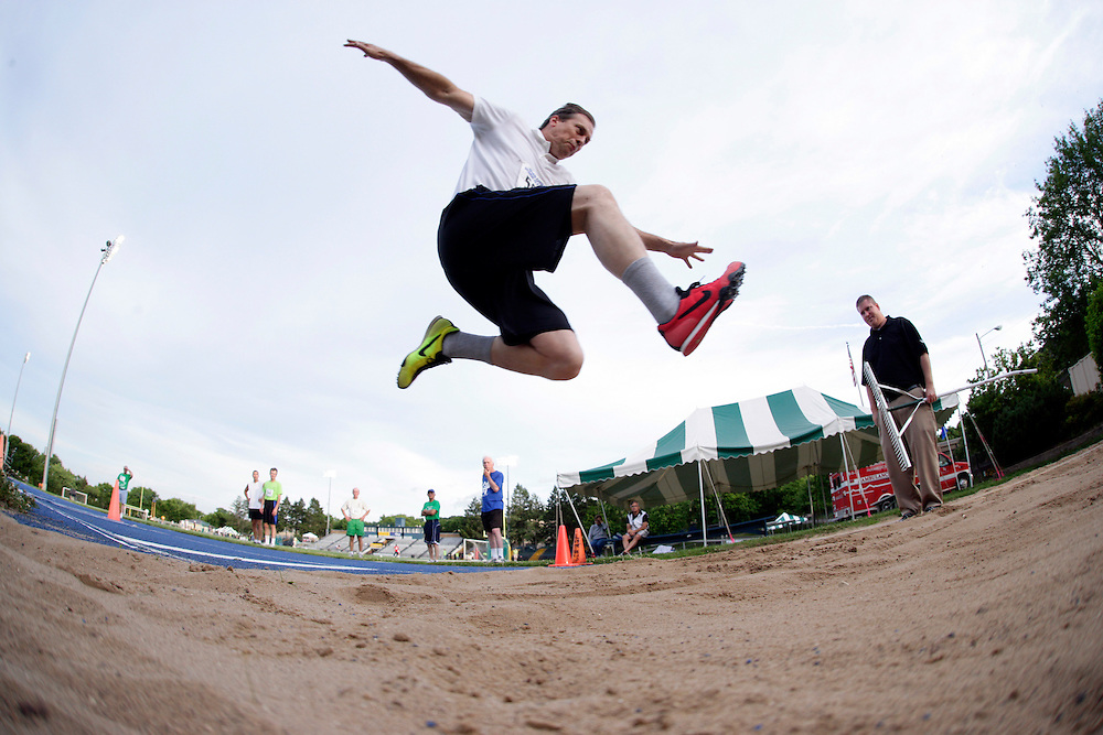 Billy Potter, 59, of Coal Valley competes in the triple jump during the Senior Olympics at the Paul V. Olsen Track at Augustana College in Rock Island, Illinois on Friday, June 24, 2011..