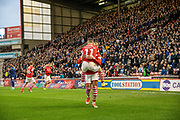 Conor Chaplin of Barnsley FC and Jacob Brown of Barnsley FC celebrating their team's first goal during the EFL Sky Bet Championship match between Barnsley and Huddersfield Town at Oakwell, Barnsley, England on 11 January 2020.