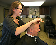 Stephany Monoenko works with a customer, Todd Little of Penfield, at The Men's Room in Brighton on Monday, June 29, 2015.