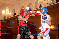 © licensed to London News Pictures. London, UK. 25/11/2011. Two amateur boxers are fighting at Mayor's Boxing Cup Tournament in Porchester Hall West London. Photo credit: Tolga Akmen/LNP