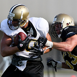 August 6, 2011; Metairie, LA, USA; New Orleans Saints tight end Jimmy Graham (80) is wrapped up by linebacker Will Herring (53) during training camp practice at the New Orleans Saints practice facility. Mandatory Credit: Derick E. Hingle