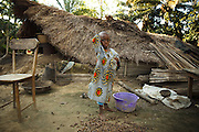 Freddy Edegan, 5, stands next to his destroyed home  in the village of Kpoto, Benin on Tuesday October 26, 2010.  Waters have receded in Kpoto, but most of the village was literally flattened by floods that have hit Benin over the past few weeks.