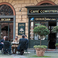 TURIN, ITALY - MAY 28:  Customers at Al Bicerin cafe, that created the historic hot drink from Turin, which is a mixture of espresso, drinking chocolate and fresh cream carefully layered in a glass on May 28, 2010 in Turin, Italy. The traditional recipe was created around 1750 in a cafe in front of the entrance of the Santuario della Consolata, where it is still served to this day.  (Photo by Marco Secchi/Getty Images)