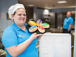 "© Licensed to London News Pictures . 04/06/2014 . Newark , Nottinghamshire , UK . ALG Bakery in Newark are selling "" by-election buns "" with coloured icing to represent the parties in the campaign for the seat in tomorrow's (Thursday 4th June 2014) by-election . Teresa Flowerdew (l) and her father Les Flowerdew's (r) unscientific sales survey shows blue for Conservative are currently polling at 46.9 percent , with purple for UKIP in 2nd place at 15.2 percent , yellow for Lib Dems at 13.1 percent and red for Labour at 10.3 percent . Photo credit : Joel Goodman/LNP"