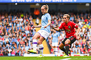 Manchester City Women midfielder Keira Walsh (24) and Manchester United Women forward Ella Toone (7) in action during the FA Women's Super League match between Manchester City Women and Manchester United Women at the Sport City Academy Stadium, Manchester, United Kingdom on 7 September 2019.