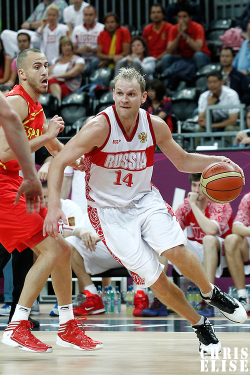 04 August 2012: Russia Anton Ponkrashov drives past Sergio Rodriguez during 77-74 Team Russia victory over Team Spain, during the men's basketball preliminary, at the Basketball Arena, in London, Great Britain.
