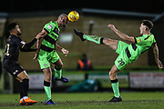Forest Green Rovers Farrend Rawson(6) and Forest Green Rovers Paul Digby(20) attempt to clear the ball during the EFL Sky Bet League 2 match between Forest Green Rovers and Mansfield Town at the New Lawn, Forest Green, United Kingdom on 29 January 2019.
