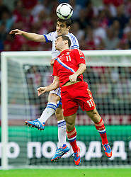 Nikos Liberopoulos  of Greece vs Aleksandr Kerzhakov of Russia during the UEFA EURO 2012 group A match between  Greece and Russia at The National Stadium on June 16, 2012 in Warsaw, Poland.  (Photo by Vid Ponikvar / Sportida.com)