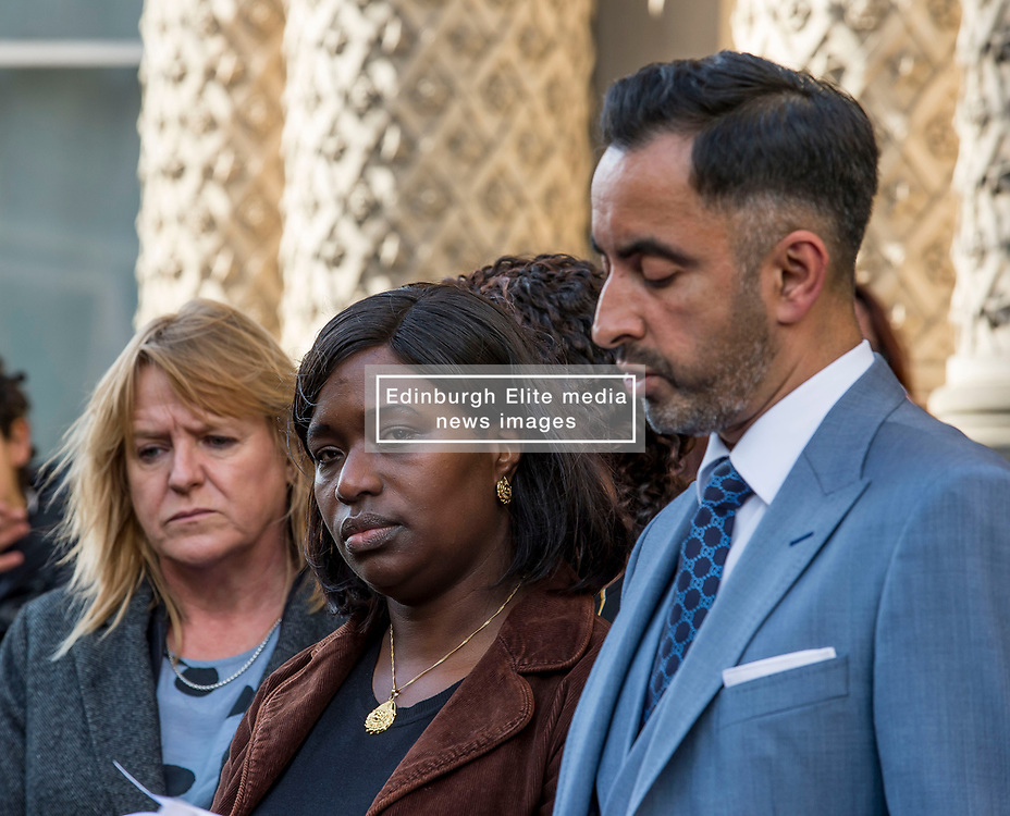 Kadi Johnson, sister of Sheku Bayoh, watches as the family's lawyer Aamer Anwar reads a statement following their meeting with the Lord Advocate.<br /> <br /> <br /> © Dave Johnston / EEm
