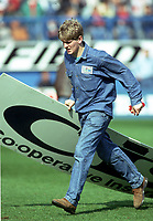 A Liverpool Fan carries away an (advertising board) to use as a Strecher for injured fans<br />The Tragic FA Cup Semi Final between Liverpool Vs Nottingham Forest where Sadly 96 Liverpool fans lost their lives because of Overcrowding at the Hillsborough Stadium Sheffiled 15th April 1989<br />PHOTO ROBIN PARKER FOTOSPORTS INTERNATIONAL