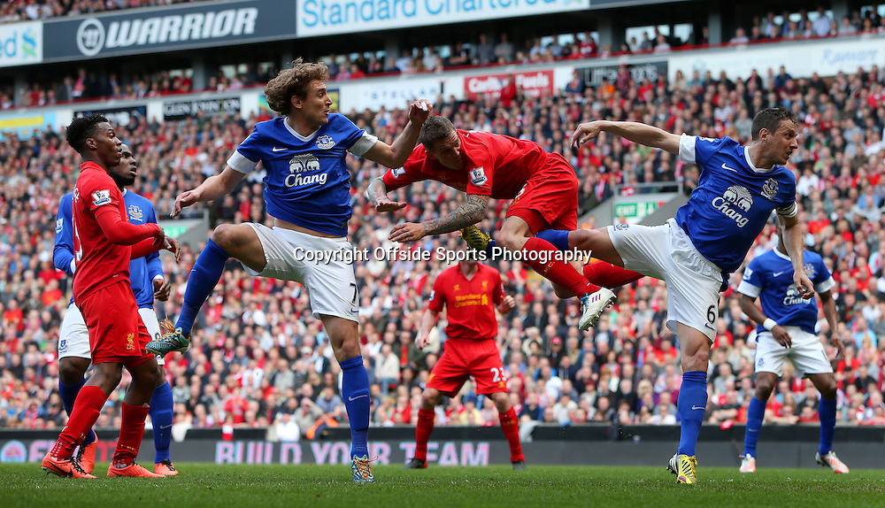 5th May 2013 - Barclays Premier League - Liverpool v Everton - Daniel Agger of Liverpool gets between Nikica Jelavic of Everton (L) and Phil Jagielka of Everton - Photo: Simon Stacpoole / Offside.
