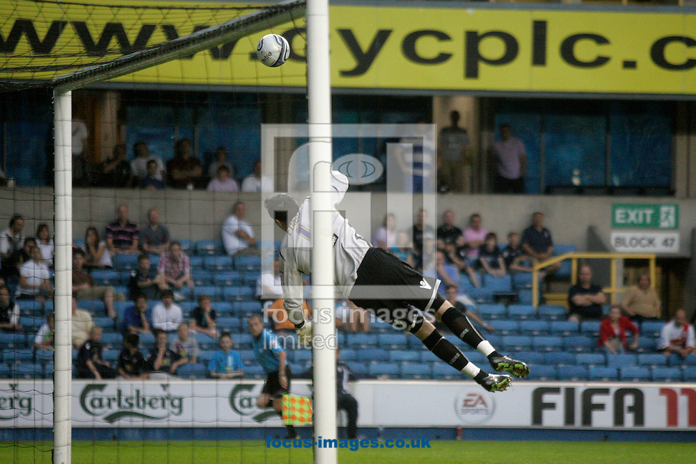 London - Saturday April 23rd 2011: Millwall goalkeeper David Forde makes an acrobatic save during the Npower Championship match at The Den, London. (Pic by Daniel Chesterton/Focus Images)