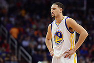 Feb 10, 2016; Phoenix, AZ, USA; Golden State Warriors guard Klay Thompson (11) reacts on the court during the game against the Phoenix Suns at Talking Stick Resort Arena. The Golden State Warriors won 112-104. Mandatory Credit: Jennifer Stewart-USA TODAY Sports