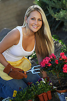 Woman gardening, smiling, portrait