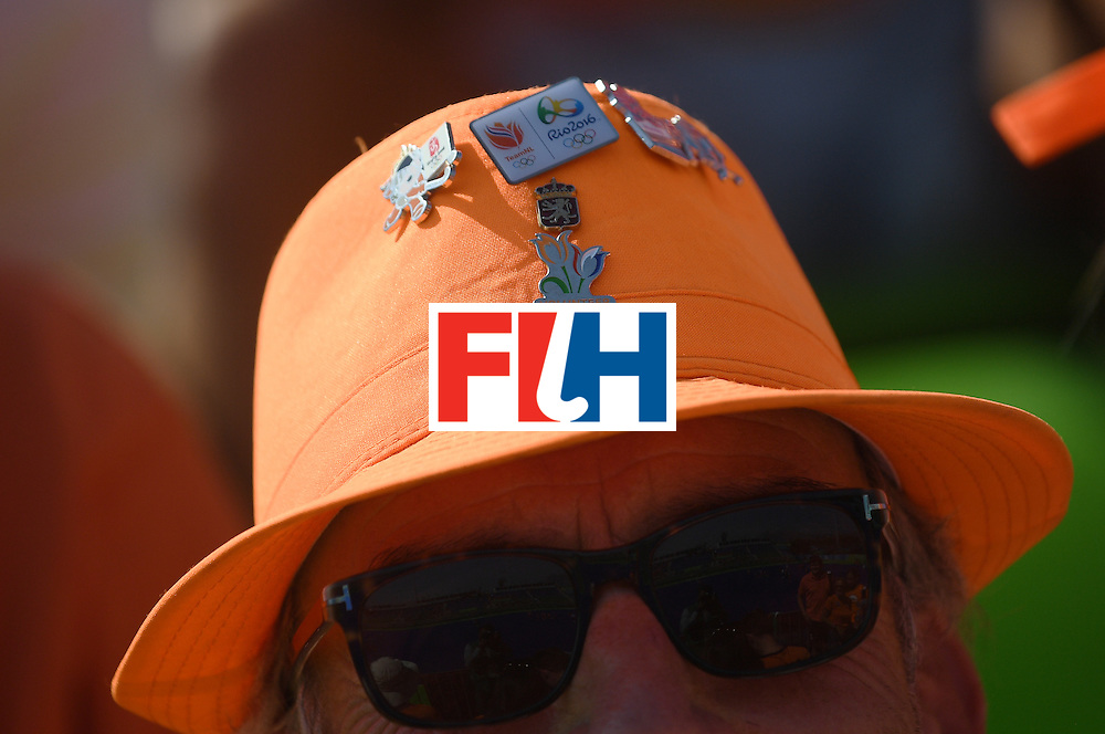 A Netherlands fan sporting some pins on his hat attends the women's semifinal field hockey Netherlands vs Germany match of the Rio 2016 Olympics Games at the Olympic Hockey Centre in Rio de Janeiro on August 17, 2016. / AFP / MANAN VATSYAYANA        (Photo credit should read MANAN VATSYAYANA/AFP/Getty Images)