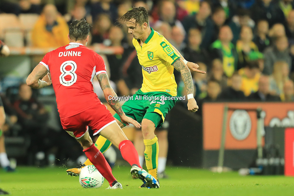 August 8th 2017, Carrow Road, Norwich, England; Carabao Cup First Round; Norwich City versus Swindon Town; James Maddison of Norwich City takes on James Dunne of Swindon Town