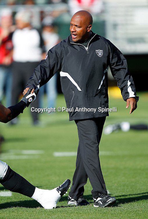 Oakland Raiders Offensive Coordinator Hue Jackson greets players during pregame warmups during the NFL preseason week 3 football game against the San Francisco 49ers on Saturday, August 28, 2010 in Oakland, California. The 49ers won the game 28-24. (©Paul Anthony Spinelli)