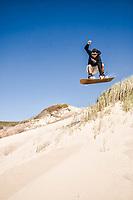 Sandboarding on the dunes of Praia Grande (Long Beach). Laguna, Santa Catarina, Brazil. / <br /> Sandboard nas dunas da Praia Grande. Laguna, Santa Catarina, Brasil.