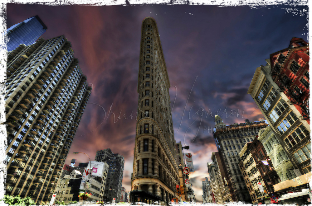 """The Flatiron Building (or Fuller Building, as it was originally called) is located at 175 Fifth Avenue in the borough of Manhattan, and is considered to be a groundbreaking skyscraper. Upon completion in 1902, it was one of the tallest buildings in the city and the only skyscraper north of 14th Street. The building sits on a triangular island-block formed by Fifth Avenue, Broadway and East 22nd Street, with 23rd Street grazing the triangle's northern (uptown) peak. As with numerous other wedge-shaped buildings, the name """"Flatiron"""" derives from its resemblance to a cast-iron clothes iron."""