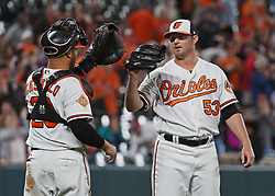 August 28, 2017 - Baltimore, MD, USA - Orioles' Zach Britton, right, celebrates with catcher Welington Castillo, left, after closing out the Mariners in the ninth inning to record his 12th save of the season Monday, Aug. 28, 2017 at Oriole Park at Camden Yards in Baltimore, Md. The Orioles won, 7-6. (Credit Image: © Kenneth K. Lam/TNS via ZUMA Wire)