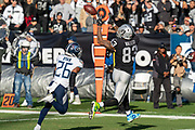 December 8, 2019; Oakland, CA, USA; Oakland Raiders tight end Darren Waller (83) catches a pass for the first down during the first half against Tennessee Titans cornerback Logan Ryan (26) at Oakland-Alameda Coliseum. The Titans defeated the Raiders 42-21. (Neville E Guard/Image of Sport)
