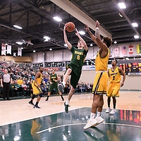 2nd year guard Benjamin Hillis (8) of the Regina Cougars in action during the Men's Basketball home game on January  20 at Centre for Kinesiology, Health and Sport. Credit: /Arthur Images