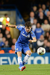LONDON, ENGLAND - September 18: Chelsea's Oscar takes a shot at goal during the UEFA Champions League Group E match between Chelsea from England and Basel from Switzerland played at Stamford Bridge, on September 18, 2013 in London, England. (Photo by Mitchell Gunn/ESPA)