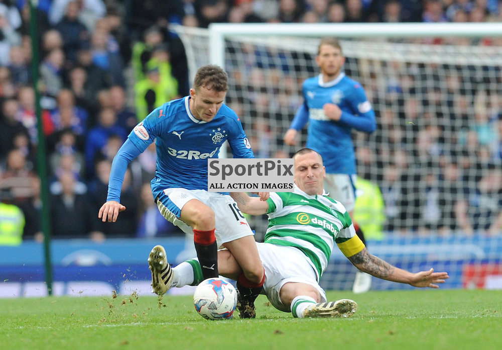 Scott Brown slides in to tackle Andy Halliday in the match between Rangers v Celtic, Betfred Cup semi-final, Hampden Park, Sunday 23 October 2016, (c) Angie Isac | SportPix.org.uk