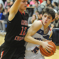 Wilmington Christian's Chris Karras drives past a Coastal defender Friday January 9, 2015 at Wilmington Christian Academy in Wilmington, N.C. (Jason A. Frizzelle)