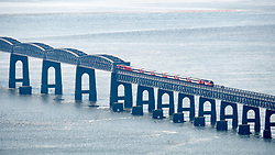 East Coast Main Line train by Virgin crossing Tay Railway Bridge spanning the River Tay in Dundee, Tayside, Scotland, UK