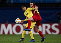 December 13, 2018 - Villarreal, Castellon, Spain - Gerard Moreno of Villarreal  and Georgi Dzhikiya of Spartak Moskva battle for the ball during the Group G match of the UEFA Europa League between Villarreal CF and Spartak Moskva at La Ceramica Stadium Villarreal, Spain on December 13, 2018. (Credit Image: © Jose Breton/NurPhoto via ZUMA Press)