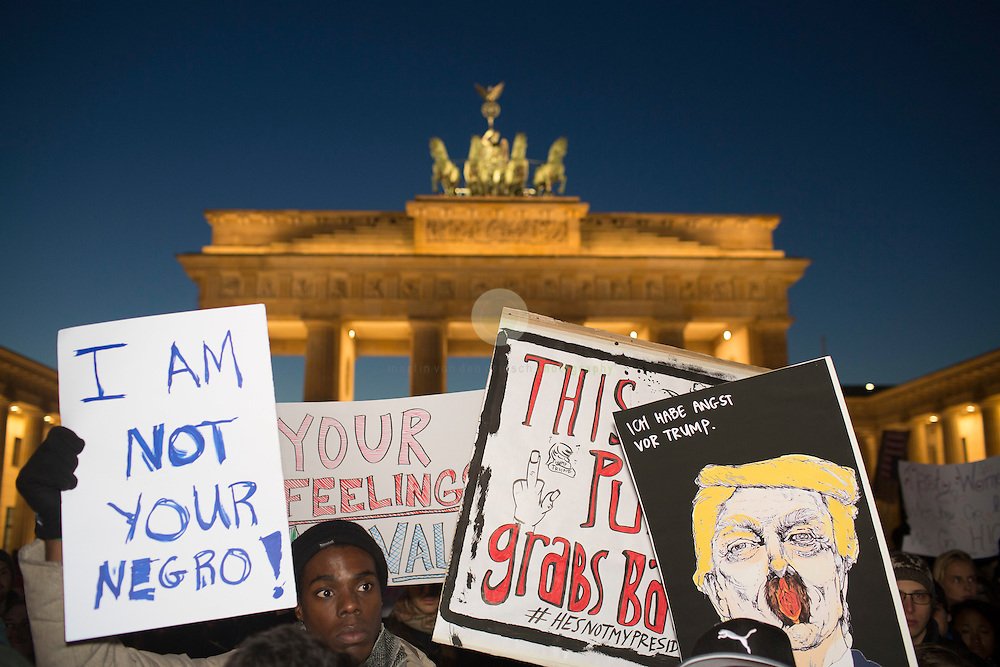 BERLIN, Brandenburg Gate, 12.11.2016 / Hundreds of people, among them many Americans, gathered in the center of the German capital to protest against President-elect Donald Trump.<br /> <br /> About 700 protesters followed a Facebook initiative to rally at the Brandenburg Gate, next to the U.S. Embassy. At this peaceful event, everyone was invited to speak out against Trump and to describe the expectations in the 45th president of the United States. Many spoke about the fear of growing discriminations against minorities.<br /> <br /> The sign on the very right reads: I am afraid of Trump