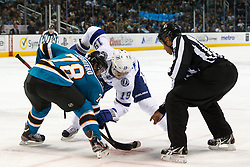 Dec 21, 2011; San Jose, CA, USA; NHL linesman Jay Sharrers (57) drops the puck on a face off to San Jose Sharks center Benn Ferriero (78) and Tampa Bay Lightning center Dominic Moore (19) during the second period at HP Pavilion. San Jose defeated Tampa Bay 7-2. Mandatory Credit: Jason O. Watson-US PRESSWIRE