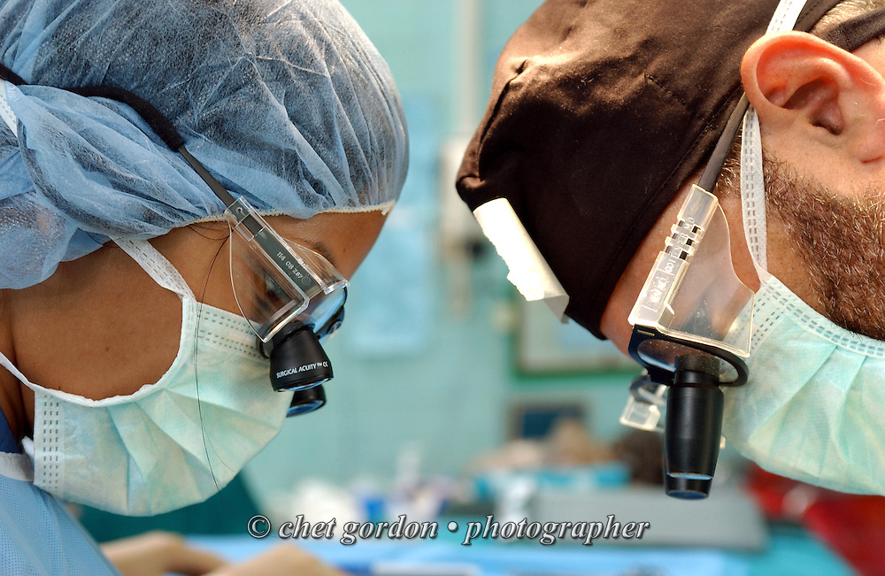 MAE SOT, THAILAND.  Venezuelan plastic surgeon Dr. Rafael Gottenger (right) of Miami, FL  is joined by a medical resident intern (left) during the first day of surgery at Mae Sot General Hospital in Mae Sot, Thailand on Monday, November 12, 2007.
