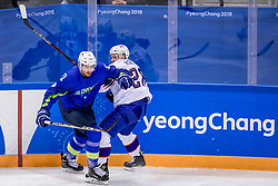 GANGNEUNG, SOUTH KOREA - FEBRUARY 20: Forward Niklas Roest #28 of Norway, forward Miha Verlic #91 of Slovenia in action during Ice - Hockey match between National Teams of Slovenia and Norway in the Men's Play-offs Qualifications on day eleven of the PyeongChang 2018 Winter Olympic Games at Gangneung Hockey Centre on February 20, 2018 in Gangneung, South Korea.  Photo by Ronald Hoogendoorn / Sportida