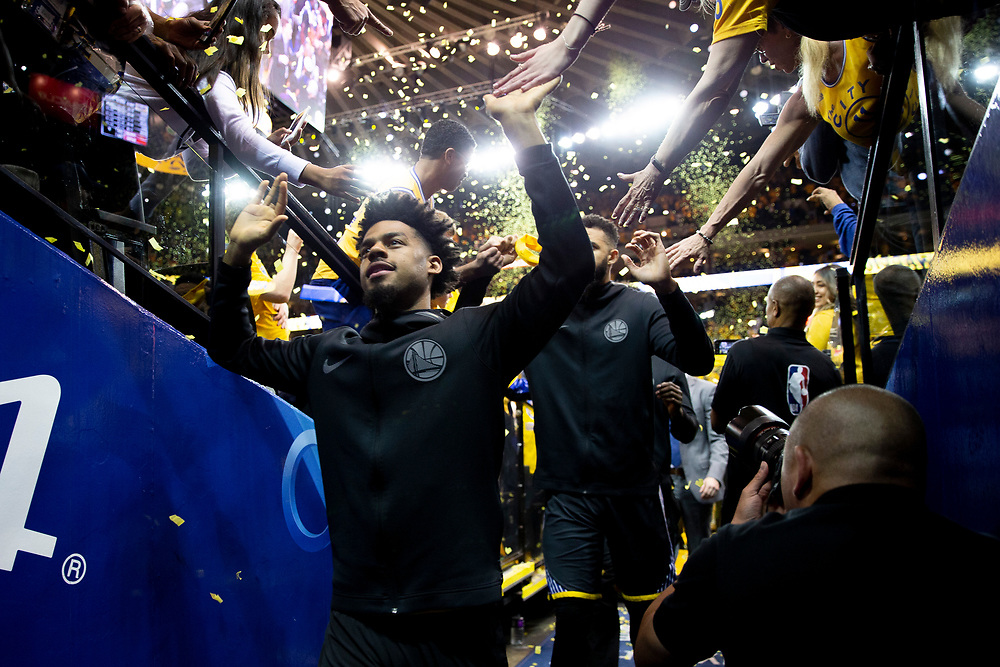 Golden State Warriors guard Quinn Cook (4) greets fans as he exits to the locker room following the end of the fourth quarter of Game 2 of the NBA Western Conference semifinals between the Golden State Warriors and New Orleans Pelicans at Oracle Arena, Tuesday, May 1, 2018, in Oakland, Calif. The Warriors won 121-116.