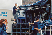 Weather proofing the DJ booth, Upper chapel Rave, Brecon, Wales, August 2016