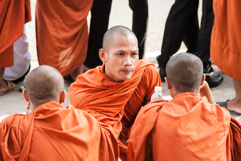 Buddhist monks chatting while waiting for the funeral parage of King